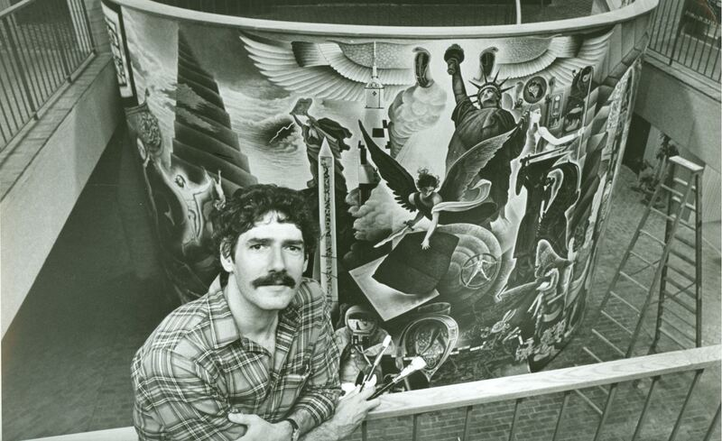 James Sicner Posing in Front of the Mural